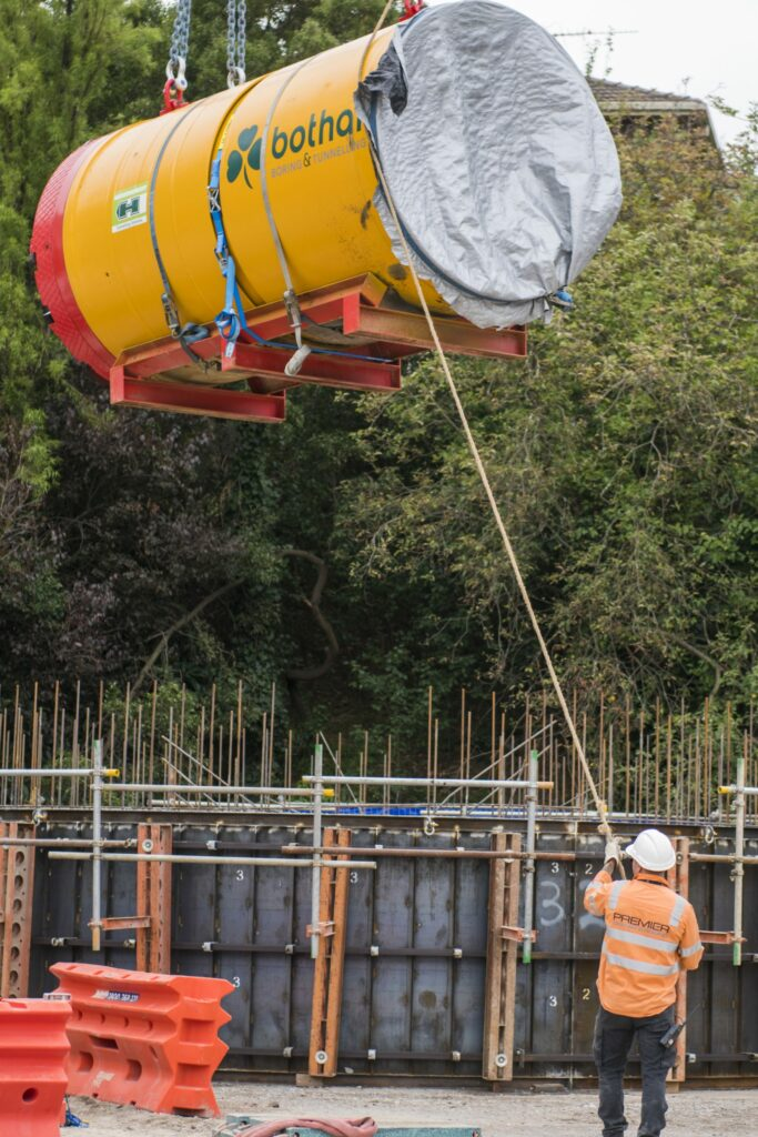 The Premier Cranes teams helps lift a Bothar Boring & Tunnelling mini-TBM into the Yarra East Main Sewer (YEMS) line.
